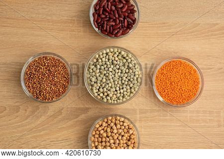 Bowls Of Cereal Grains: Chickpeas, Red Lentils, Red Bean, Green Peas, Sorghum Grain