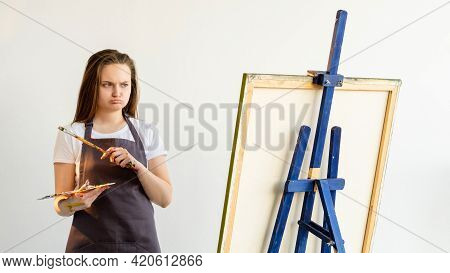 Bad Result. Female Artist. Creating Process. Muse Inspiration. Unsatisfied Skeptic Woman With Brush