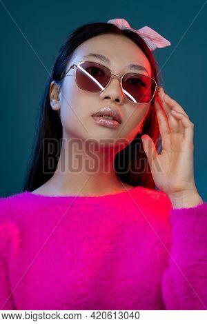 Eyewear Fashion. Neon Portrait. Modern Accessories. Confident Glamour Asian Girl In Stylish Sunglass