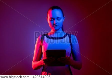 Cyber Communication. Ict Network. Futuristic Technology. Smart Neon Light Woman Using Tablet In Pink