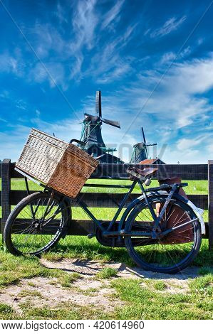Bicycle With Windmill And Blue Sky Background. Scenic Countryside Landscape Close To Amsterdam In Ne