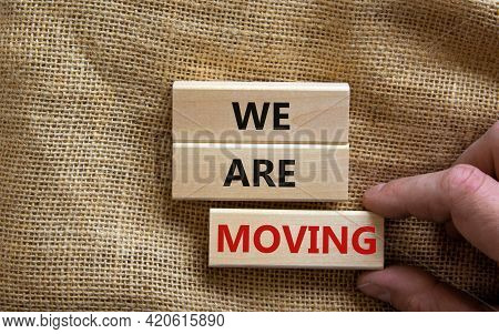 We Are Moving Symbol. Wooden Blocks With Words 'we Are Moving'. Beautiful Canvas Background, Busines
