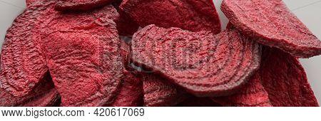 Crispy Dried Food. Organic Tasty Chips. Homemade Snacks. Sliced Beetfood. Healthy Vegetables. Trend