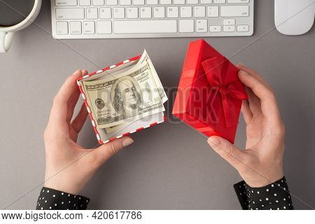 First Person Top View Photo Of Woman's Hands Holding Open Red Giftbox With Money Hundred Dollars Ban