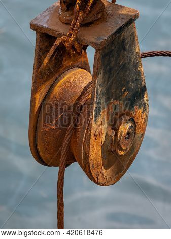 A Rusty Trawler Pully By The Sea