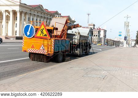 A Special Car Is Sweeping The Street. The Municipal Service Is Cleaning Up The City. The Concept Of