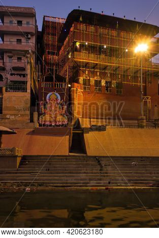 Varanasi, India - November 01, 2016: Bunch Of Wooden Boat Docked In Ganges River Next To Empty Ghat