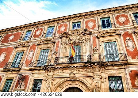 Old Colorful Episcopal Palace Facade In Murcia Under Blue Sky