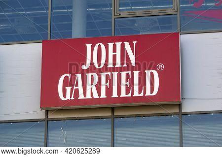 Ostrava, Czech Republic - April 28, 2021: The Storefront Of John Garfield Shoes Seller On A Modern B