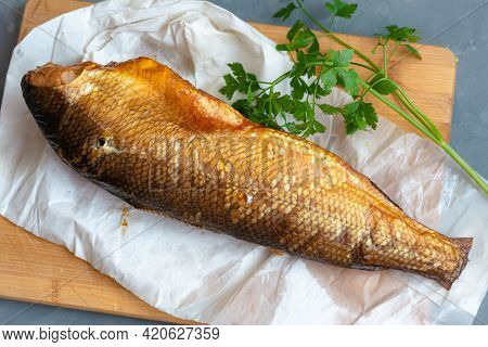 Smoked Whitefish On A Wooden Board.