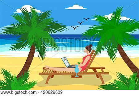 Woman Lying In A Deck Chair With A Laptop And Having A Tropical Cocktail Under The Palm Trees By The