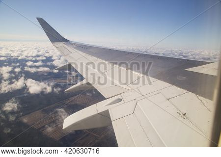 The Wing Of The Plane. View From The Porthole.the Plane.flying By Plane.