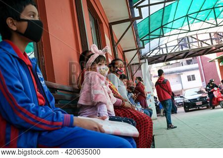 Kathmandu, Nepal, 16 March 2020: People Wearing Protecting Face Masks Outside A Hospital, Waiting Fo