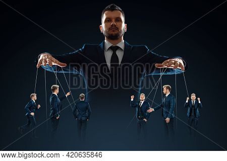 A Man, A Puppeteer, Controls The Crowd With Threads. The Concept Of World Conspiracy, World Governme