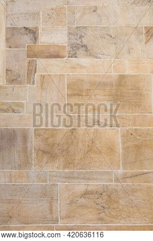 Close up of weathered stone cladding of a wall from old architecture. Grunge floor made with sand stone.