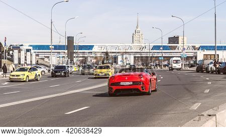 Rear View Of Red Ferrari California Diving In The City Street. Rental Supercar. Rich People's Millio