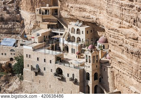 Monastery Of Saint George In The Canyon, Wadi Qelt, Israel. Temple In The Rocks In The Gorge. Judean
