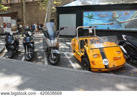 Barcelona, Spain, 1.09.2020 - Go Car Parked In Scooter Parking Lot In Barcelona, Go Car Is Touristic