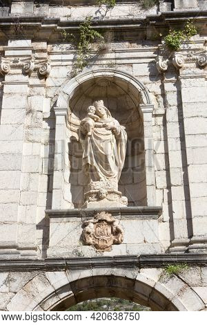 Tarragona, Spain, May 1, 2020 - Statue Of Virgin Mary With Baby Jesus On Facade Of Old Monastery Car