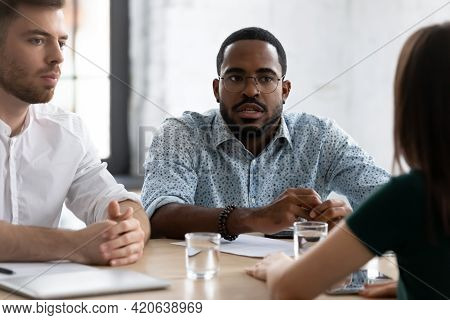 Focused African American Hr Manager Talking To Job Candidate