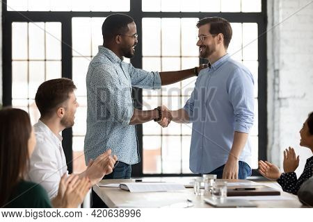 Happy African American Male Boss Welcoming New Hired Employee