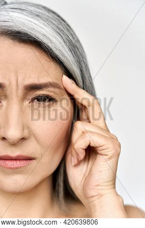 Closeup Cut Portrait Of Mature Old Senior Mid Aged Asian Ethnicity Woman Suffering From Headache Mig