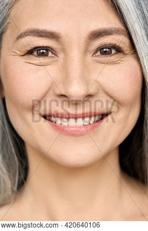 Happy Smiling Senior Older Middle Aged Asian Woman With Grey Hair And Radiant Face With Perfect Skin