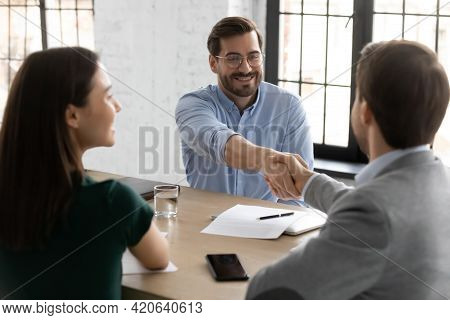 Happy Employee Candidate Shaking Hands With Employer Or Recruiter