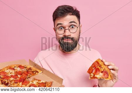 Confused Surprised Unshaven Young Man Eats Tasty Pizza Has Fast Food Addiction Enjoys Tasty Snack In
