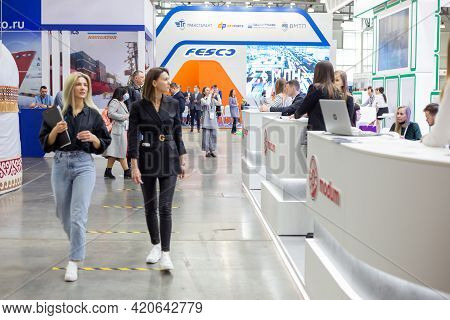 Moscow, Russia - 14 April 2021 : Visitors To The Exhibition Inspect The Exhibition Stands At The Int