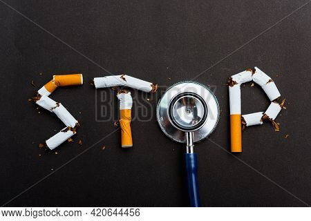 31 May Of World No Tobacco Day, No Smoking Close Up Word Stop Spelled Text Of The Pile Cigarette Or