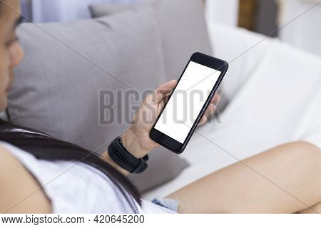 Close Up Hands Of Woman Using Mobile Phone, Cell Phone In Coffee Shop. Hands Of Women Holding Blank