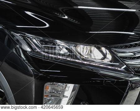 Novosibirsk, Russia - May 16, 2021: Mitsubishi Eclipse Cross,   Headlight Of A Modern Popular Car Cl
