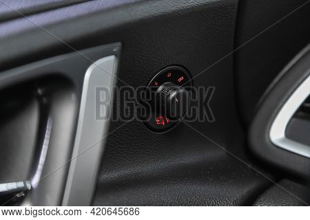 Novosibirsk, Russia - May 16, 2021: Opel Astra,    Close-up Of The  Buttons: Side Mirror Adjustment