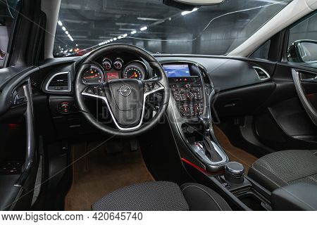 Novosibirsk, Russia - May 16, 2021: Opel Astra,   Dashboard, Player, Steering Wheel With Logo And Bu
