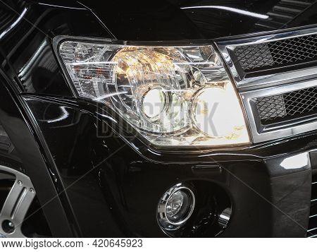 Novosibirsk, Russia - May 16, 2021:mitsubishi Pajero,   Headlight Of A Modern Popular Car Close-up.