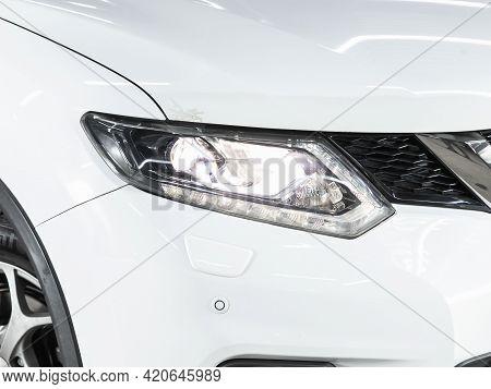 Novosibirsk, Russia - May 16, 2021: Nissan X-trail,   Headlight Of A Modern Popular Car Close-up. Sh