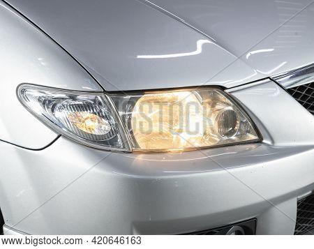 Novosibirsk, Russia - May 16, 2021: Mazda Premacy,   Headlight Of A Modern Popular Car Close-up. Shi