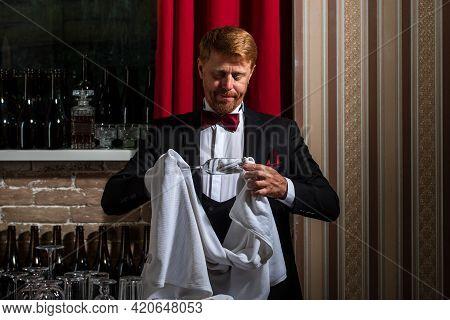 Bartender Rubbing Glass. Male Barman Clean Glass. Restaurant Staff Cleaning. Waiter Bartender.