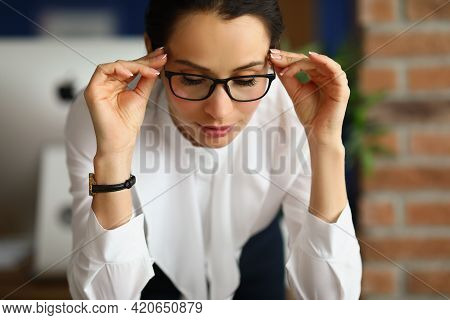 Portrait Of Young Businesswoman Taking Off Taking Off Her Glasses