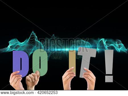 Composition of do it text in multi coloured letters held by people with green light trails. motivation and encouragement concept digitally generated image.