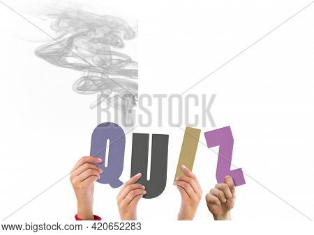 Composition of quiz in multi coloured letters held by people with grey smoke. knowledge and thinking concept digitally generated image.