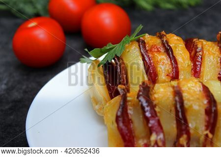 Potato Stuffed With Salami, Cheese, Ketchup, Garlic And Herbs. Baked Whole Potatoes Is Sliced And St