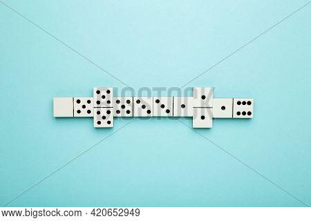 Playing Dominoes On Blue Background. Domino Effect. Top View