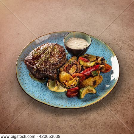 Grilled Pork Chop Steak With Grilled Vegetables Served With Garlic Sauce