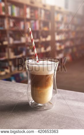 Transparent Glass With Latte Macchiato. Layers Of Coffee With Milk