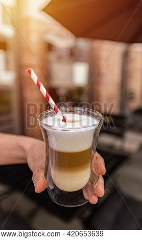 Tempting Glass Of Latte Macchiato Served Layered And Topped With Cream