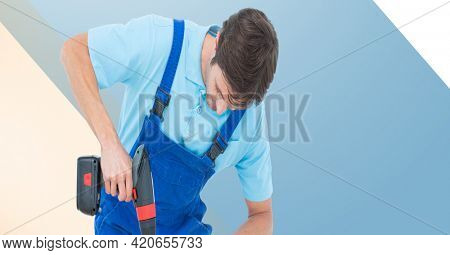 Midsection of handy man holding drill on blue, beige and white stripes. diy and home decoration concept digitally generated image.