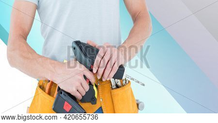 Midsection of handy man holding drill on blue and white stripes. diy and home decoration concept digitally generated image.