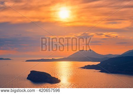 Aegean Sea with Greek islands view on sunset. Cape Sounion, Greece